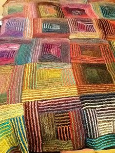 This is a multi colored knitted patchwork blanket. Nice.