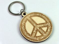 Engraved Wooden Keychain Peace by InvenioCrafts on Etsy, €6.00
