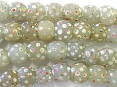 Trade Beads |  Old milky white Venetian 'skunk' or 'eye' beads, produced for the African Trade.