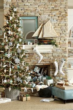 Think outside the box when sprucing up your Christmas mantel. We accented this stone fireplace with a large mirror and a model ship to compliment the blues and whites of our Christmas tree!