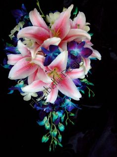 Large teardrop bouquet of pink oriental lilies, blue and white Singapore orchids and white roses.