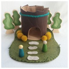 Step inside this storybook tree stump cottage. It is just waiting for imagination to move in.  The play possibilities are endless!  This wool felt play mat is hand stitched and measures approximately nine inches by twelve inches.  Small parts Not intended for children under the age of three Spot clean only accessories NOT included trees available in my shop www.mybigworld2015.etsy.com  Thank you for visiting my little shop of Imagination.