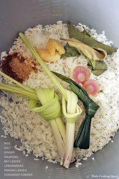 Basic nasi uduk ingredients: rice, lemongrass, pandan leaves, bay leaves, ginger, galangal, coriander, and salt.