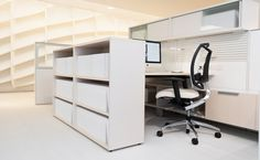 District with storage by Teknion