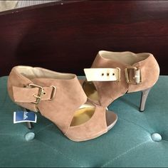 Tan suede heals Stylish leather tan heals brand new. There is a tiny scratch on one of the heals. Nine West Shoes