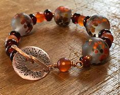 Handmade Autumn Lampwork Bead Bracelet with Faceted Carnelian & Etched Leaf Copper Toggle Clasp