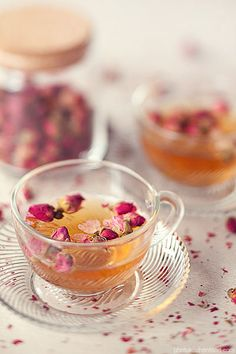 I love Rose Hip tea! It comes out all pink and delicate looking, and has that delightful, light, lemony flavor. One tea house I went to added a couple of rose buds on top like this, just for decoration. Lovely.