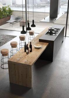 Cuisinière moderne en gris anthracite avec coin repas en bois