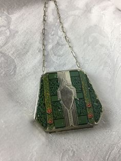 A personal favorite from my Etsy shop https://www.etsy.com/listing/264571586/edwardian-compact-tiny-purse-antique