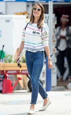Alessandra Ambrosio keeps it casual in jeans, striped top and round sunnies with a double bridge.
