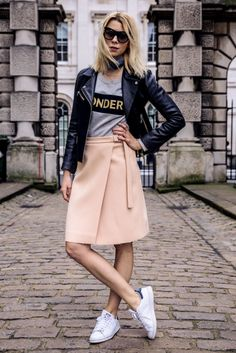 Pink wrap skirt, grey shirt, black leather jacket, white sneakers