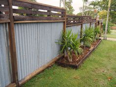 Recycled hardwood timber fence, rusty corrugated iron. Timber joist and bearers salvaged from house demolition. Planed, sanded & oiled All DIY by Myself . Robina, GOLD COAST, QLD