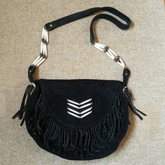 Vintage black suede fringe crossbody bag Made of 100% suede. Has some bone and silver bead accents. 2 small silver conchos on the strap areas. Only flaw is that one of the bone beads came off from the strap (as shown on the 2nd photo) - i do have it but dont know how to attach it back on (will be given to the buyer). Vintage  Bags Crossbody Bags