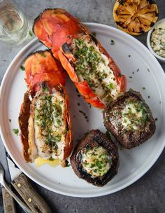 Our Grilled Surf and Turf is made with a Petite Filet Mignon and Lobster Tails, both grilled and then finished with an herb compound butter. Rib Recipes, Cooking Recipes, Game Recipes, Seafood Recipes, Grilled Carrots, Smoked Pork Shoulder, Filet Mignon Steak, Grilled Lobster, Grilling