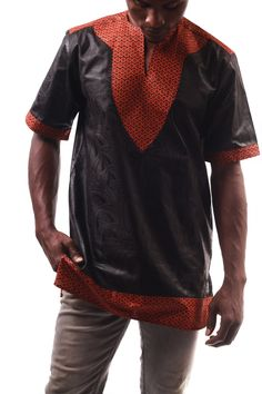 FARABA- combination of black damask embossed with an intricate design and the red trimming vibes of the print in our new shape and style of African T-shirt for 2016. Sourced, designed and manufactured in The Gambia. - 100% cotton  - Authentic African Wax Prints   - Fitted design    - Retain their colour SeeSize GuideandGarment Care