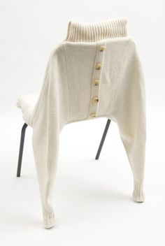 Claire-Anne O'Brien: Chairwear Using details and construction techniques traditionally associated with knitwear garments such as ribs, cuffs, button holes, fully fashioning and cut and sew to create jumpers for chairs.