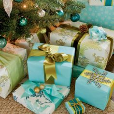 Customize Wrapping    Mix simple, solid-colored paper with artisan prints. By attaching vintage ornaments and even pinecones to packages, you can make them work with your other decorations.