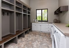 Chicago Brick tile from #sunderlands, Sherwin Gauntlet Gray lockers with barn board seat #bellahomesiowa