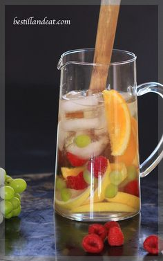 What is more perfect on a sunny summer afternoon than a pitcher of white wine sangria? A pitcher of red wine sangria served with it of course!  Click the pic for Sangria Two Ways