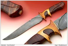 An Integral SHF in twist pattern damascus, bronze, and jarrah wood. Approximately $2500.