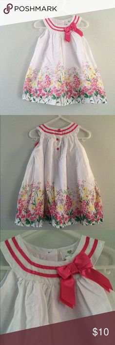 Beautiful baby girl floral Dress Worn once. White dress with pretty flowers and pink bow. Dresses