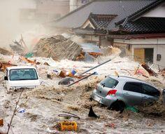Kakichi Saijo took this dramtic photo while escaping from the tsunami, in Rikuzentakata, Iwate Prefecture, on March 11, 2011. (Provided by Kakichi Saijo)