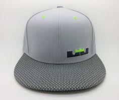 150e6c2a68de3 Nike Lebron James 12 Dunkman Snapback Hat for sale online