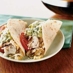 Fish Tacos with Creamy Lime Guacamole and Tangy Slaw.