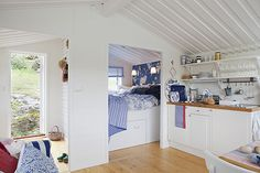 Swedish summer cottage in bright white, blue and red. Pretty!