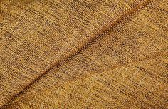 Salvinetti Upholstery Fabric in Gold is a rich gold textured fabric with dark brown threads woven throughout, creating dimension and a beautiful sheen. Which colorway of this low cost #interiordesign fabric would you add to the Metallic and Black Curated Fabric Colleciton?
