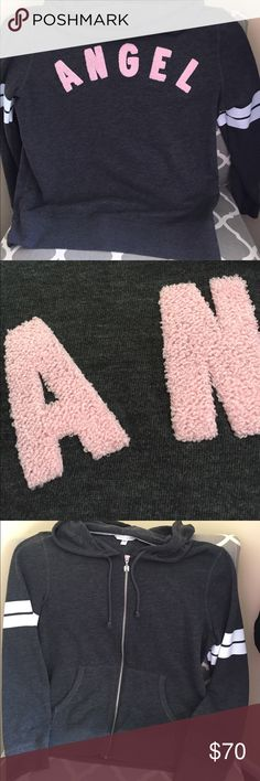 Victoria's Secret angel hoodie Dark grey with white stripes and pink looped lettering on back. Very Light piling on sides where arms rub, other than that it is spectacular!! Victoria's Secret Tops Sweatshirts & Hoodies