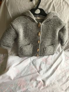 Crafty Bears latest creation baby jacket. This one has been made in baby grey wool in size 6-12 months but can be made in other colours and sizes. Like what you see have a look around Crafty Bears Facebook page or message for more details.