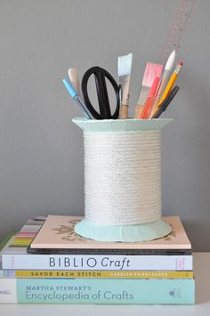 A giant DIY spool to keep your desk organized.