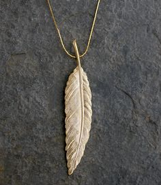 Gold Feather Necklace, $62.00, via Etsy.