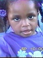 """Missing: DIAMOND YVETTE BRADLEY. 07/06/2001; DOB: November 25, 1997. Place of Birth: Chicago, IL. Height: 3'0"""". Weight: 40 pounds. Hair: Black.   Eyes: Brown.   Sex: Female.   Race: Black. Disappearance: She was last seen wearing purple ponytail holders in her hair. She has a scar on the left side of her scalp, has deep-set eyes, and is described as timid but loves to talk."""