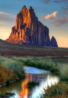 Shiprock, sacred to the Navajo. Shiprock is a monadnock rising nearly 1583ft above the high-desert plain of the Navajo Nation in San Juan County, New Mexico, United States. Its peak elevation is 7177ft above sea level. It lies about southwest of the town of Shiprock, which is named for the peak.