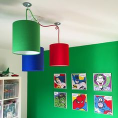 Cluster of 3 plain bright small lampshades hung with a 3 way multi way kit