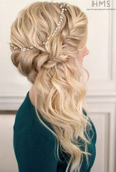 Pull your long waves into a braided crown and push your curls to one side for an elegant hairdo