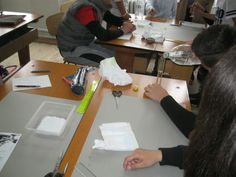 Students from Scoala Gimnaziala 4 Fratii Popeea, Romania measuring water for the first addition to the hydrogel.