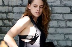 If there's anyone who can pull off this hipster-turned-vamp look AND flash a bit of lingerie at the same time – it's Kristen Stewart.  Her scooped tank top exposed a bit of bra as the pretty brunette visited a trendy eatery in the exclusive Los Feliz neighbourhood.  She appeared to grab a few colas (colas, what a great word for fizzy pop) and make a quick exit from the Home diner in Los Angeles.
