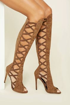 cb717c091164 A pair of faux suede boots featuring strappy sides