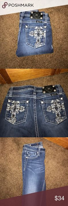 SIZE 14 GIRLS MISS ME JEGGINGS Size 14 Girls Miss Me Jeans. Style: Jeggings. Beautiful rhinestone crosses on both back pockets... no stones missing!! Color: DK 85. Inseam: 30 Great condition. Smoke free home. Miss Me Bottoms Jeans