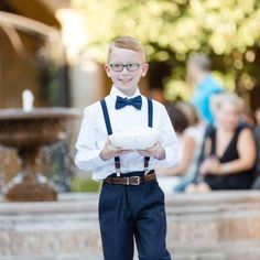 All smiles as this ring bearer walks down the ailse  | Leslie Ann Photography | villasiena.cc