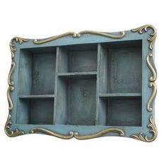 """Showcasing a distressed blue finish and scrolling motif, this wood shelf brings classic appeal to your entryway or mudroom.  Product: Wall shelfConstruction Material: WoodColor: BlueFeatures: Six compartments Dimensions: 15.75"""" H x 23.5"""" W x 4.75"""" D"""
