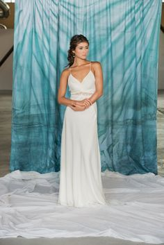 Lily $1945 - Flowing and elegant, the simplicity of the Lily gown is complemented with delightful details like crossover spaghetti straps and a…