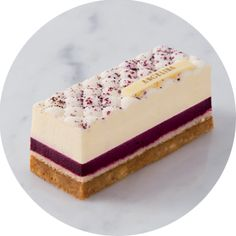 Cassis Cheesecake Discover the cheesecake revisited by Angelina. The meeting between the mild creamcheese, crunchy biscuit and almond tart flavors of cassis. Crispy crumble, light almond biscuit, creamy blackcurrant mousse creamcheese