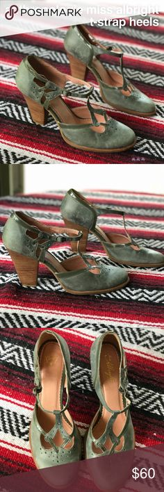 "Anthropologie Miss Albright T-Strap Heels Beautiful sage green and brown vintage inspired leather Mary Jane t-strap heels with adjustable buckle closure. Closed toe. Heel is 4"". Some small scuffs in the leather give the shoes a unique, one of a kind look. Gently worn, in excellent condition. ModCloth style. Anthropologie Shoes Heels"
