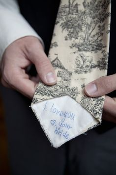Bride writes on grooms tie