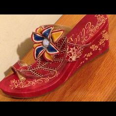 6d77496ee Shop Women s Corkys Elite size 9 Shoes at a discounted price at Poshmark.  Description  Stunning Corkys Elite Hand painted Leather slip on Wedges.