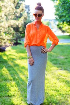 long skirt, loose-fit sheer top, big sunglasses, bun on top
